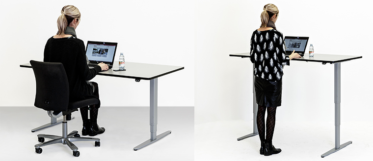 ErgoDesk user sitting standing